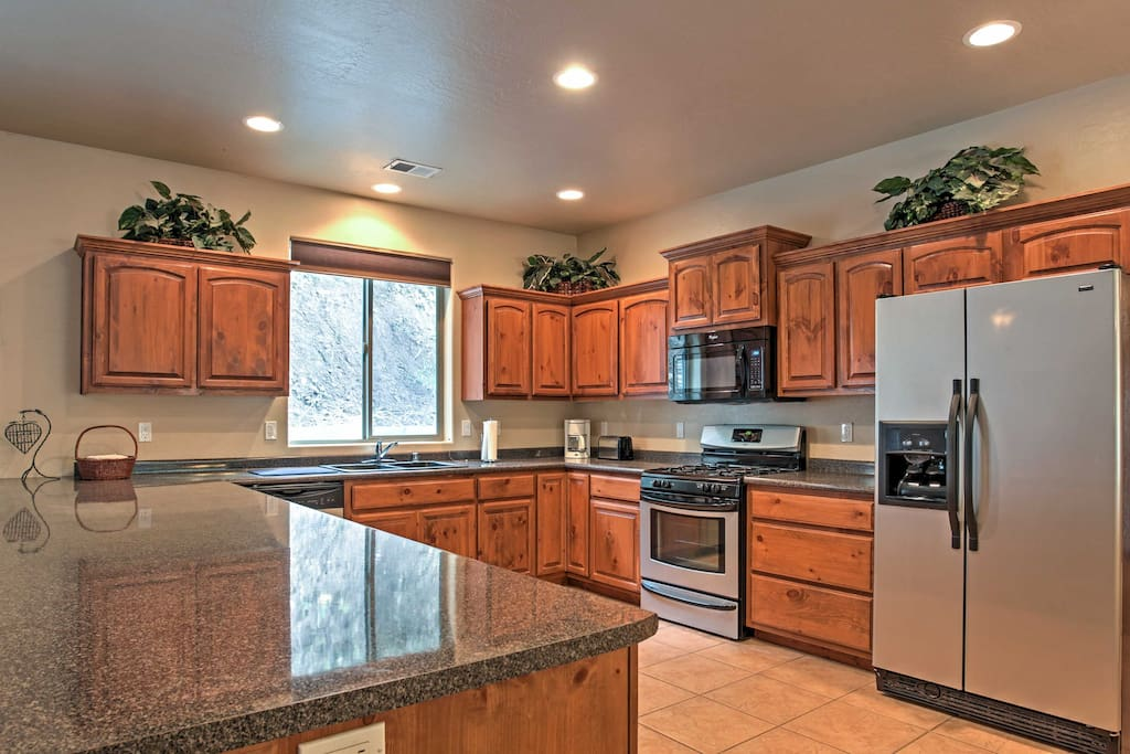 Whip up inspired home-cooked meals for your friends and family in this spacious, fully equipped kitchen.