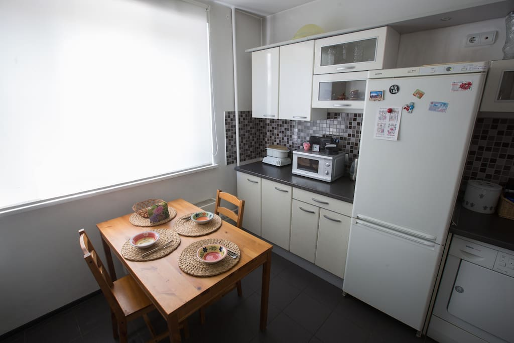 The kitchen is equipped with a refrigerator, stove, oven, microwave, dishwasher, washing machine and dryer.