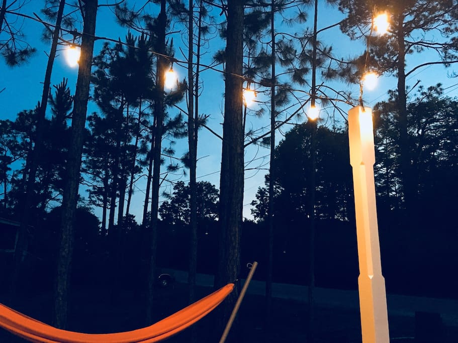 Hammock and string lights set the tone for relaxation.