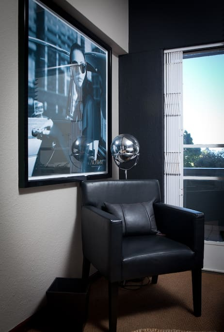 Occasional leather chair and Raak light for additional ambience creation. Lighting is key for sexy mood-setting...