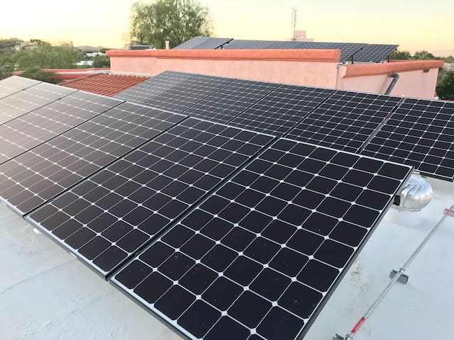 Solar panels on the roof of the house provide electricity for the house and the casita.