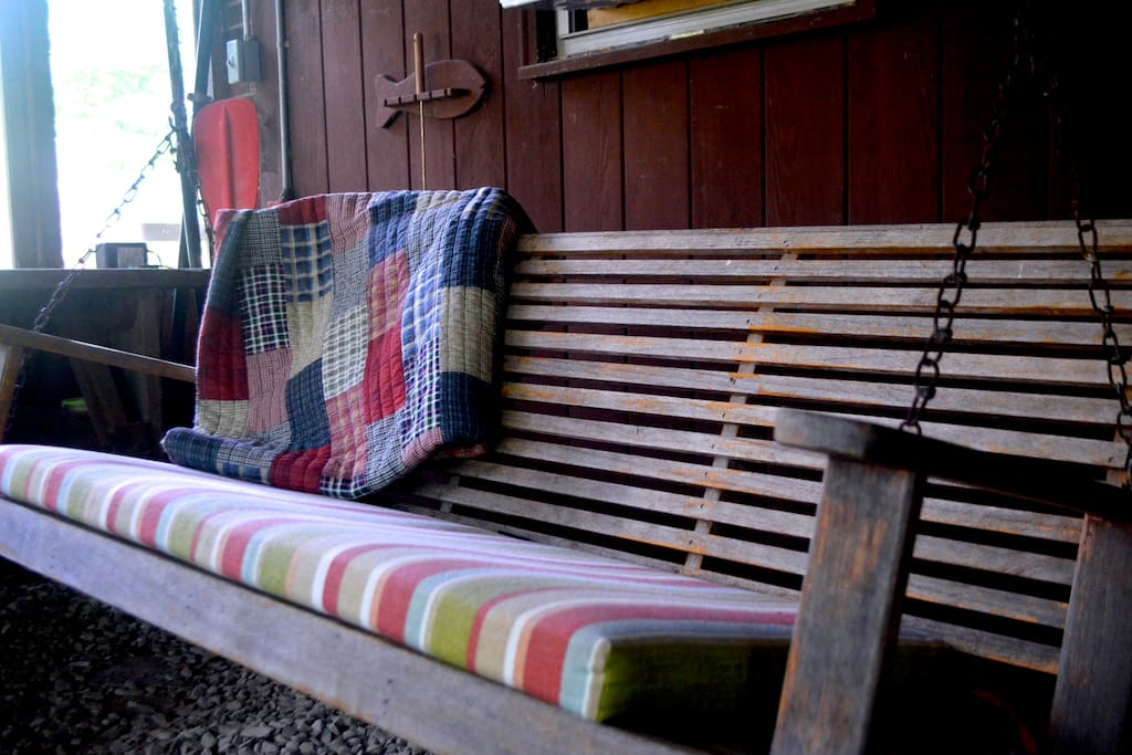 Relax and read a book on the porch swing.