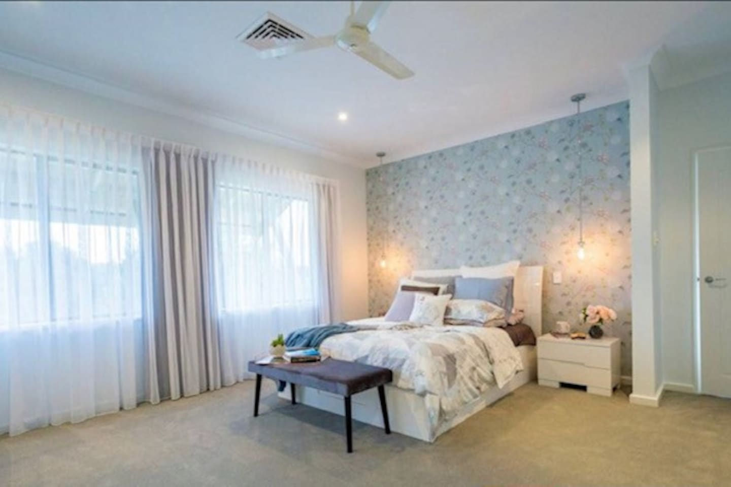 Queen Size bed with aircon, ceiling fan and views overlooking Big Swamp Nature Reserve