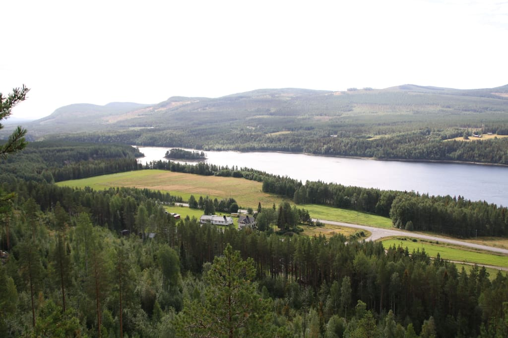 The view from the Bredsel hill, overlooking the house and the Pite River Valley. The road to the right  is a 10 minute walk to the Storforsen Hotel.