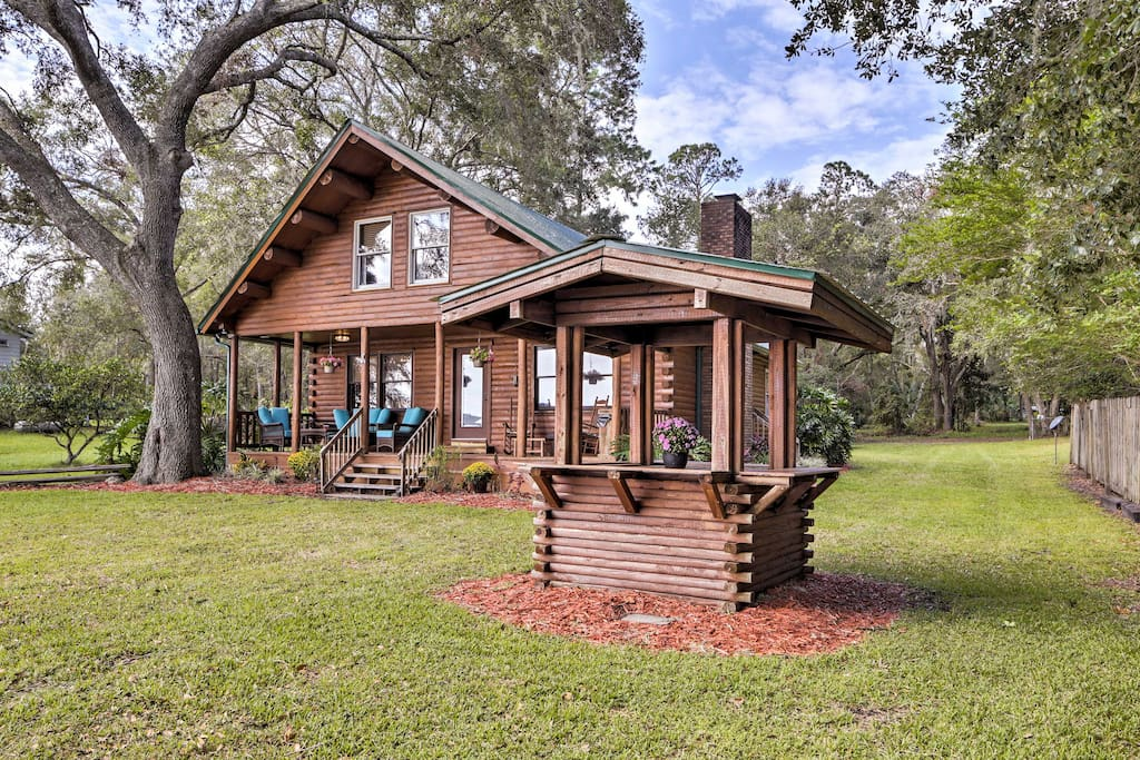 This rustic log cabin boasts over 1,000 square feet of lakefront living space.