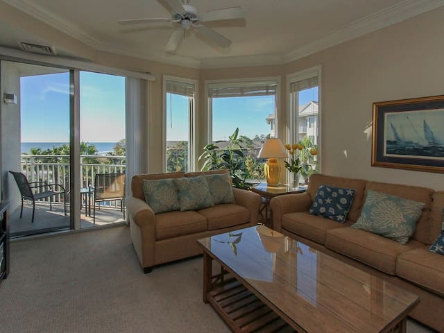 Living Room with Balcony Access and Flat Screen TV