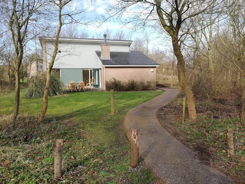 Private bungalow steps away from Kijkduin Beach