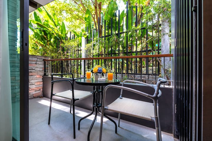 Balcony with outside furniture to enjoy the garden view