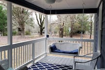 Porch swing on front porch - take your coffee or libation with!