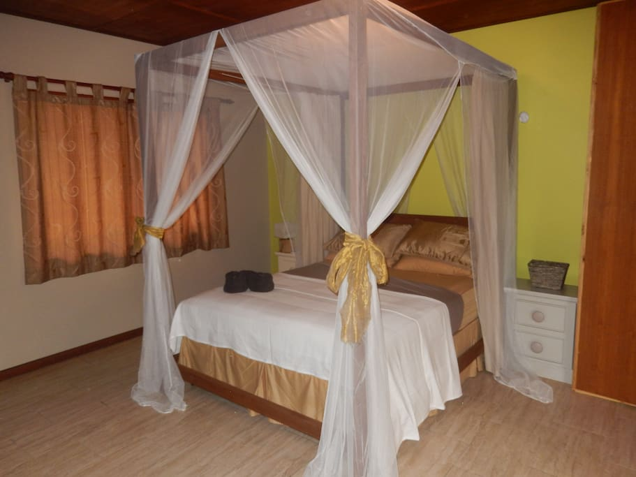 Romantic bedroom at the villa..wake up to the bird singing good morning in paradise.