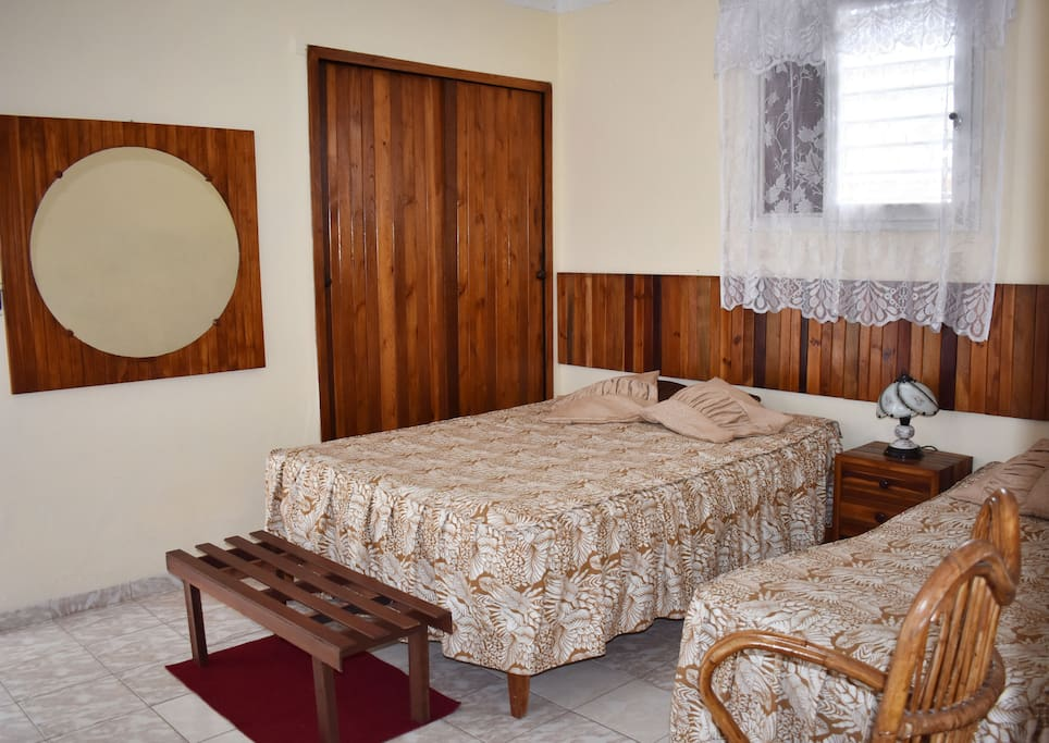 Bedroom with private bathroom, air conditioned and fridge.