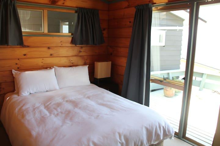 Queen bedroom 1 in the house, opens onto deck.