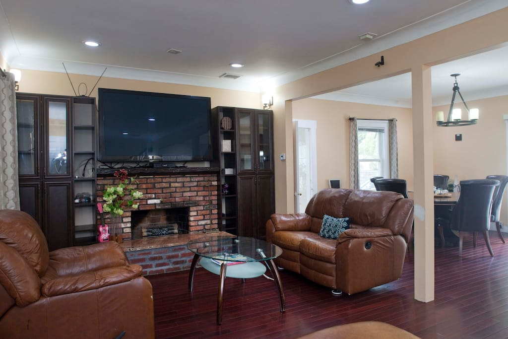 """Living room with soft leather sofas and 65"""" Flat screen TV with Fios Cable TV Internet"""