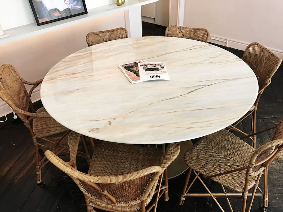 Dining table for 6-8. Light grey & baby pink vein marble table, wicker chairs
