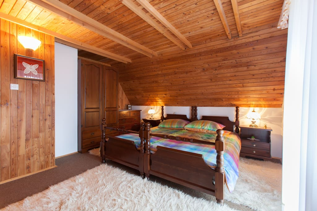 Master bedroom for two. Brighter in airy. With exit to balcony with view to Cerknica Lake.