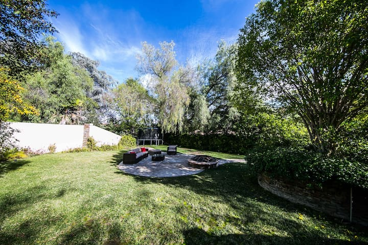 Upper level garden with wooden fire pit