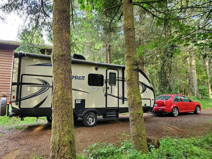 Camping in the trees. Dry RV parking.