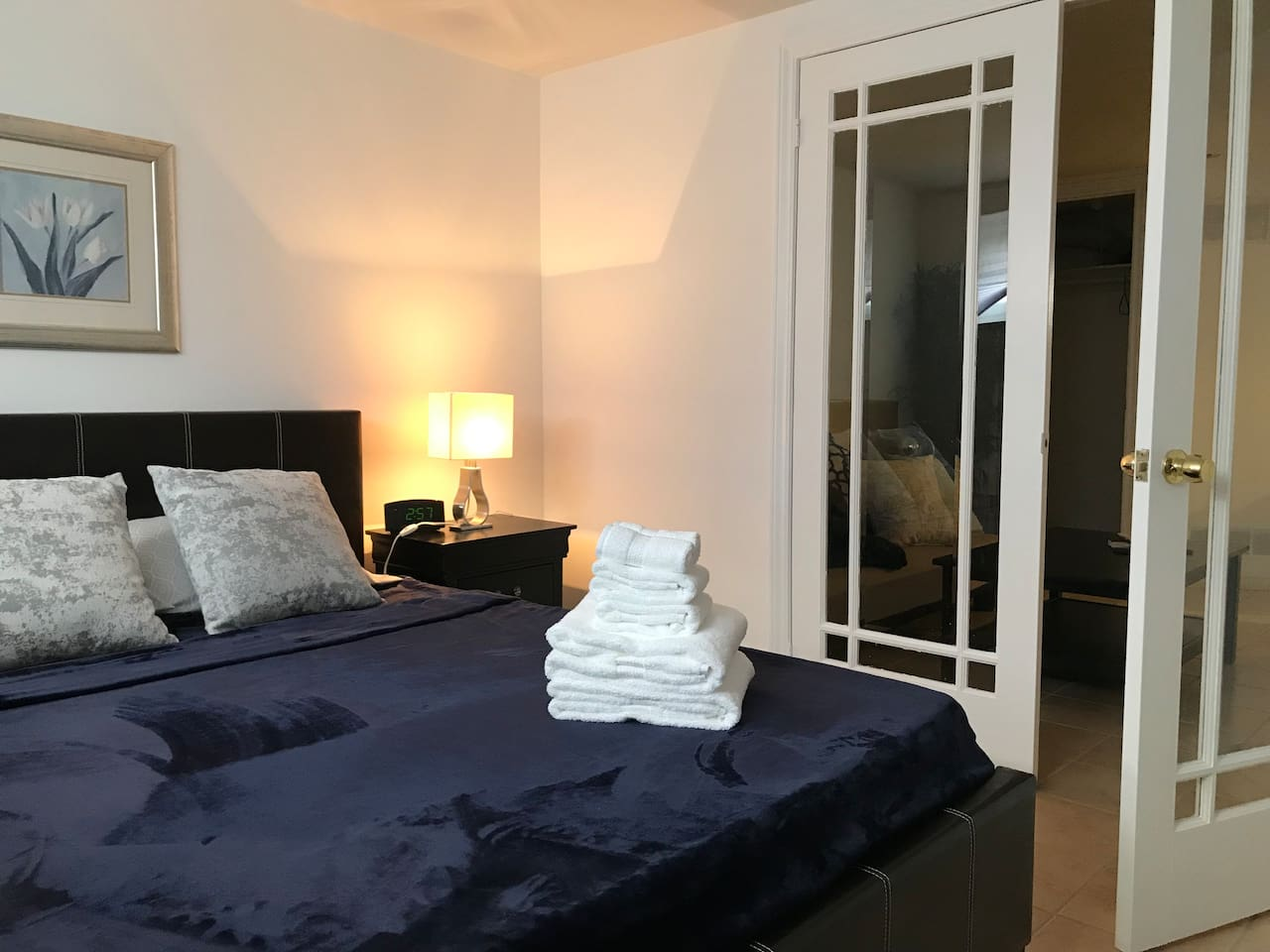 Queen size bed in separate bedroom with French doors