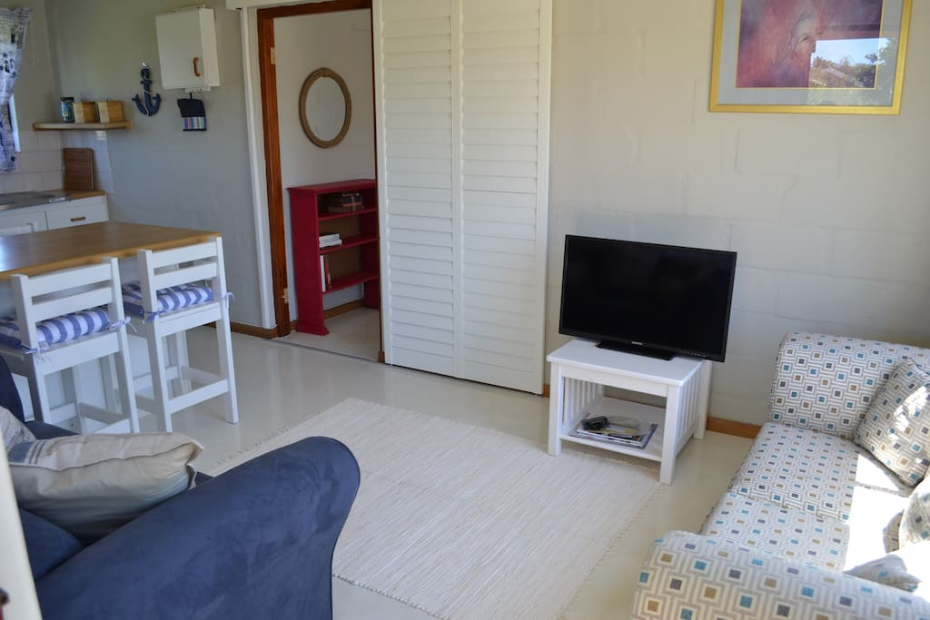 The lounge and small kitchen are fully equipped and suitable for a couple