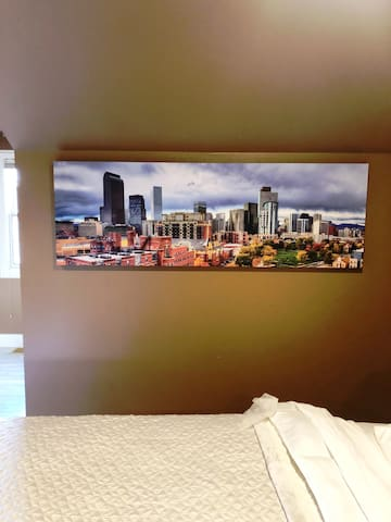 """Since a """"Beautiful Space within a Beautiful Place""""  is minutes from the city of Denver we celebrate Denver with this nice piece of art in the King Bedroom."""