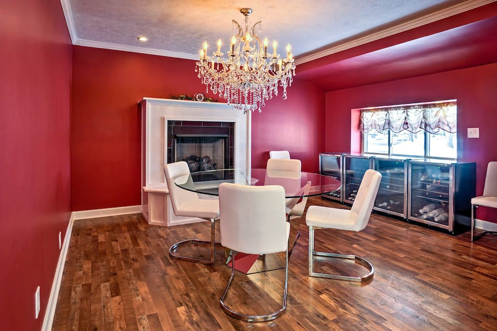The cherry-red dining area features a 4-person table next to a gas fireplace.