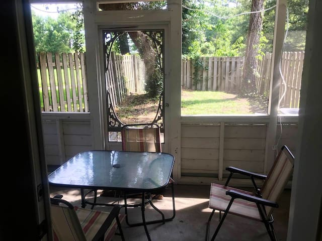 Screened in back patio/ fenced in back yard