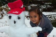 Vedini with a snowman in winter