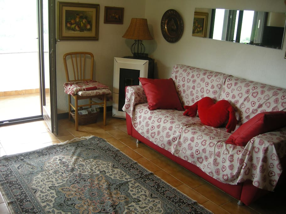 Upstairs: sofa bed & pellet stove