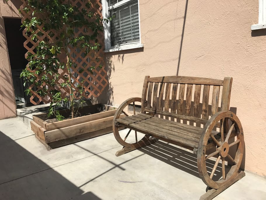 Relax in the front on the cute rustic bench
