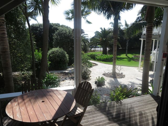 view of the tropical gardens from the deck.  Walk across the road to the beach