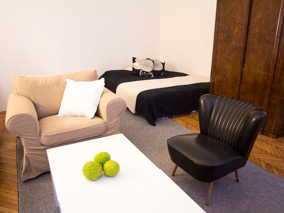 Your own spacious room with a couch, double bed, and work desk