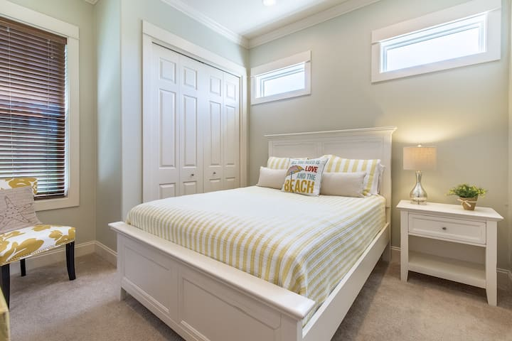 Both guest bedrooms on the second floor feature a queen bed.