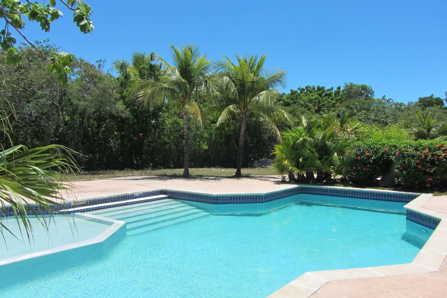 Nice saltwater pool awaits you.  Total remodel with new floors, new paint, new fridge, decorations, and a new kitchen with new microwave, new cookware, induction cooktop, all new lights, new ceiling fan, and a smart tv