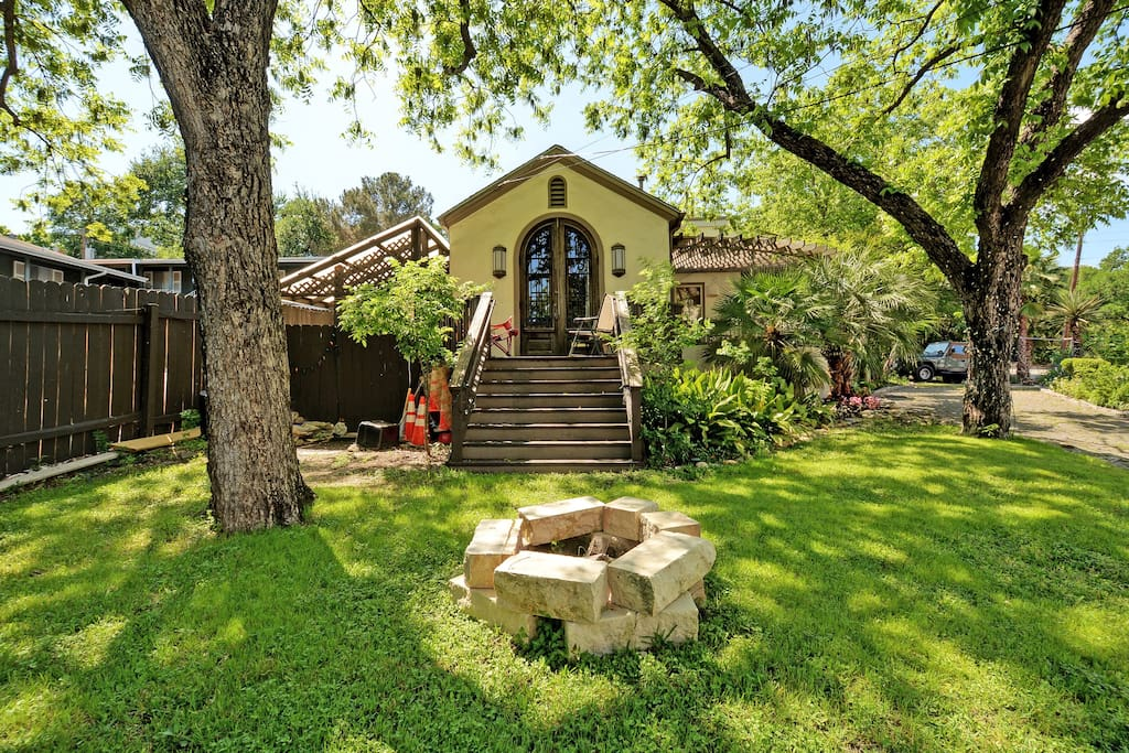 Outdoor fire pit and Texas charm in the shaded yard.