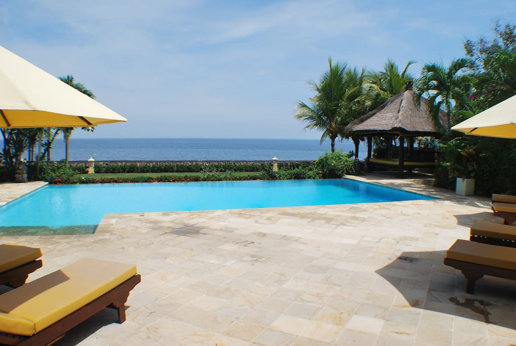 View over sun terrace and large pool to the Bali Sea