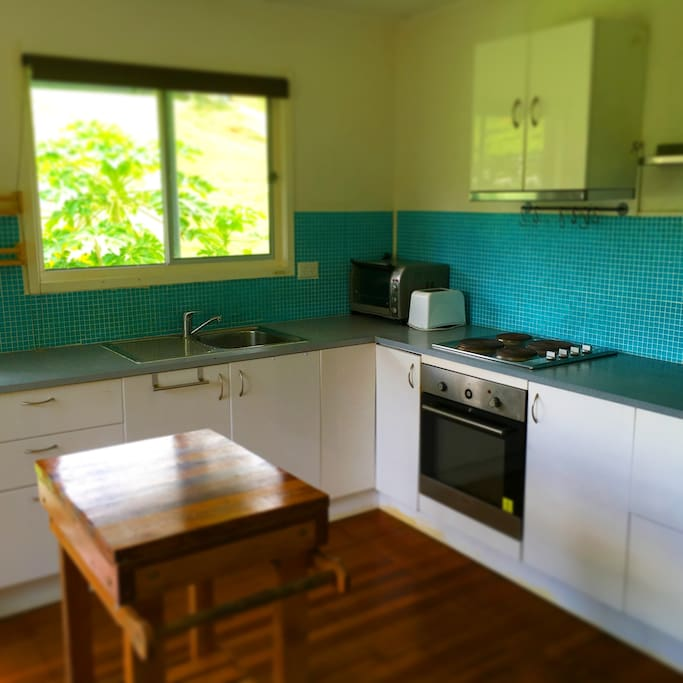 Kitchen with the oven and stove top, toaster, kettle and micro wave are available