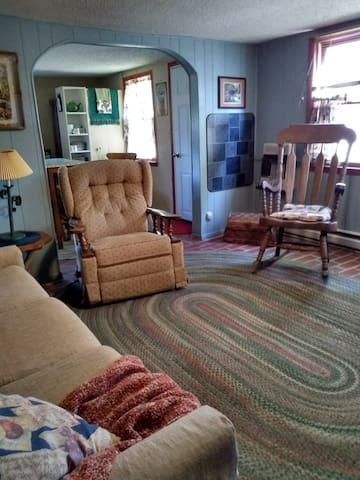 Living room.  Comfy recliner and rocker!