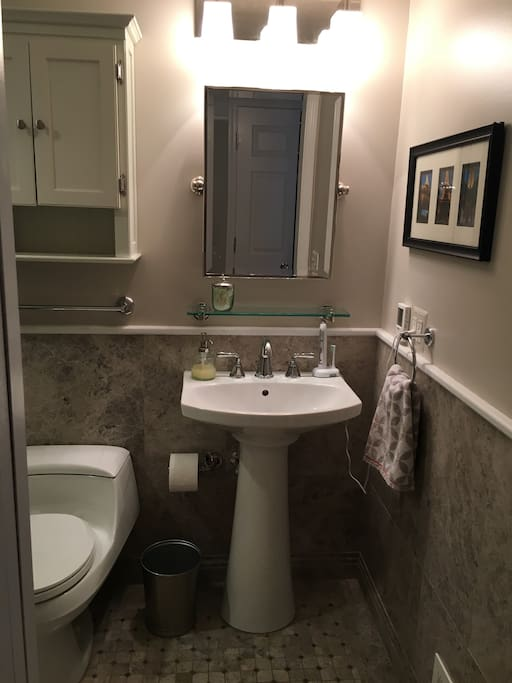 Bathroom with heated floors and a walk-in shower with glass door.
