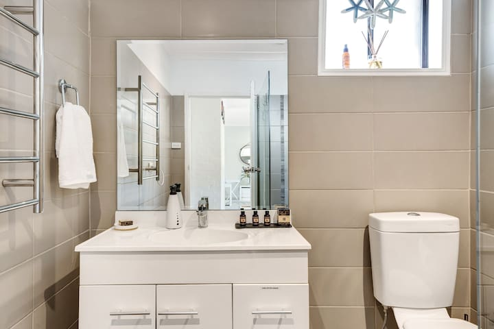 Bathroom with heated towel rail, hairdryer and essential toiletries to keep you feeling fresh.