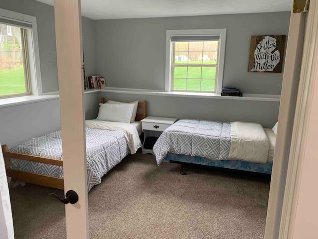 Twin beds, one mattress is memory foam.