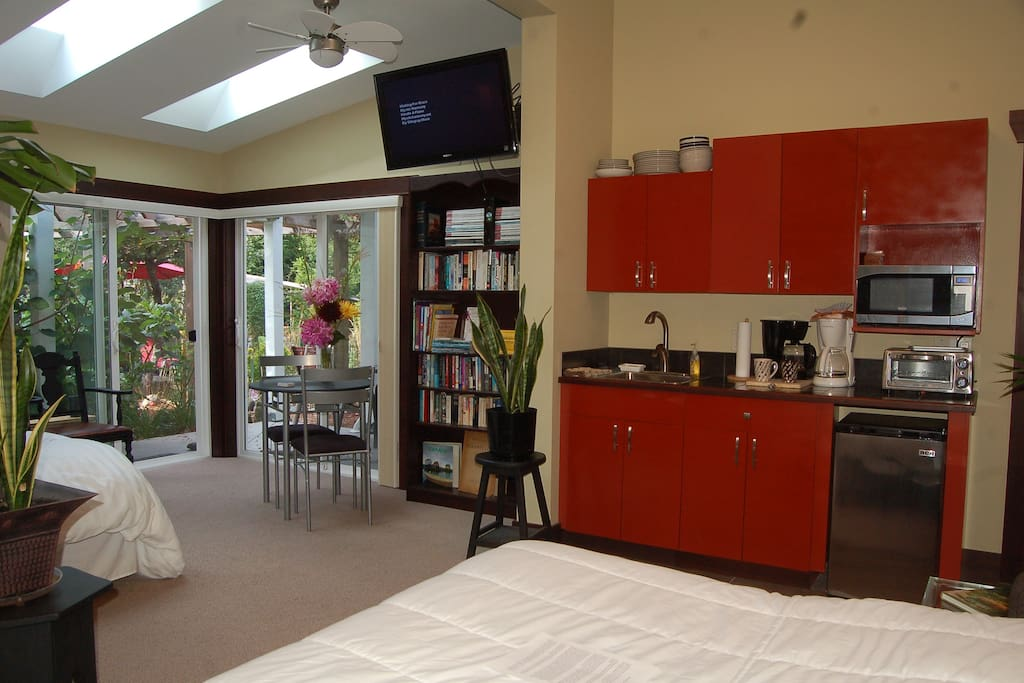 Garden Suite includes kitchenette, library, ceiling fans, TV, 3 skylights, 3 private entrances, views of gardens & waterfalls