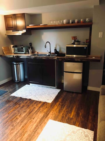 Kitchenette includes mircrowave, coffee pot, small griddle, fridge & sink