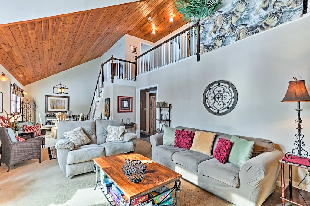 Boasting stunning knotty pine cathedral ceilings and a large flat screen TV, the living area will quickly become your favorite place to gather.