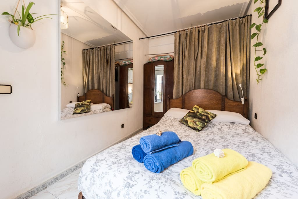 the bedroom, simple, white, clean and relaxing, plenty of electrical sockets and wardrobe to hang clothes extra hanging behind the curtain.