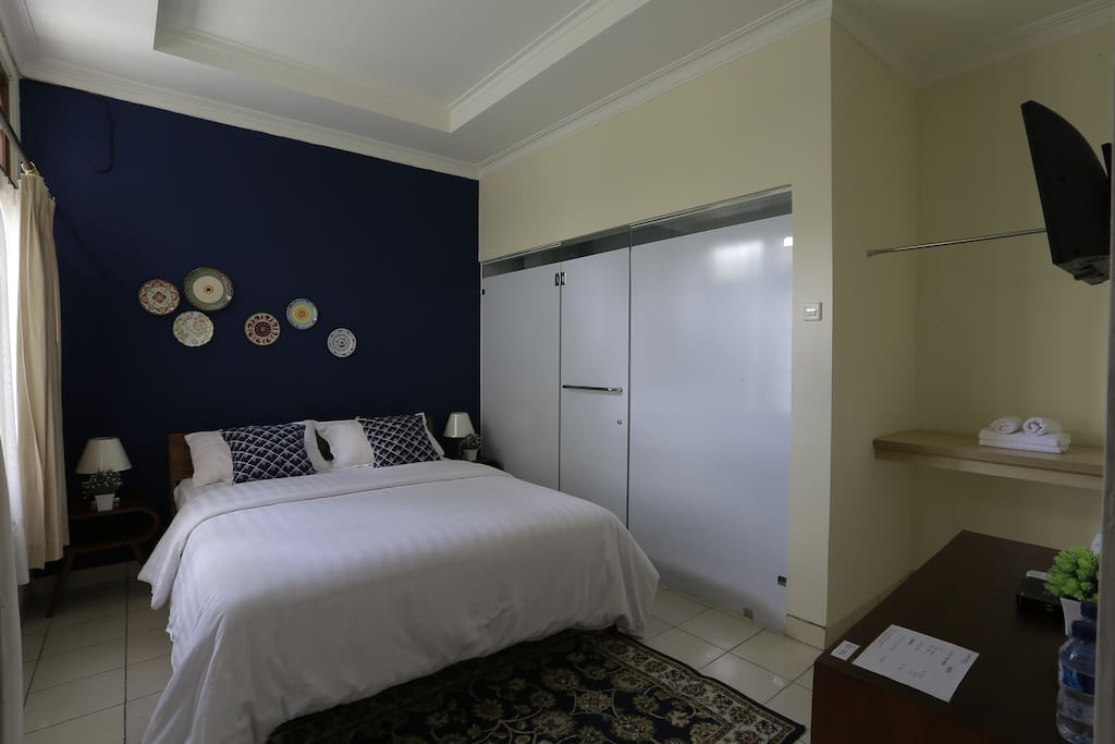 Our Blue double bedroom provides you with comfort like its your home away from home. This room is complete with clean linen and your own private bathroom.