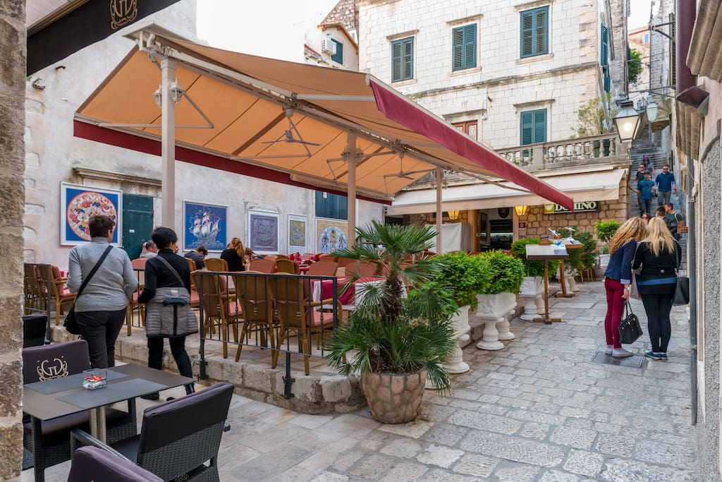 Located in Domino street, numerous restaurants among ancient traditional stone houses...