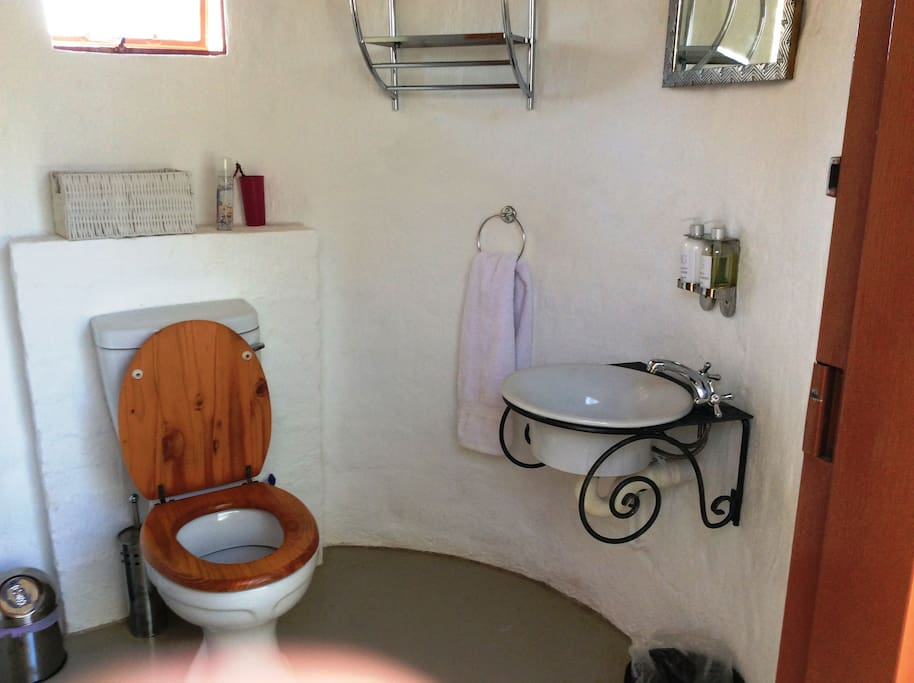 Small rondavel with Toilet and Basin accessed via a private courtyard.