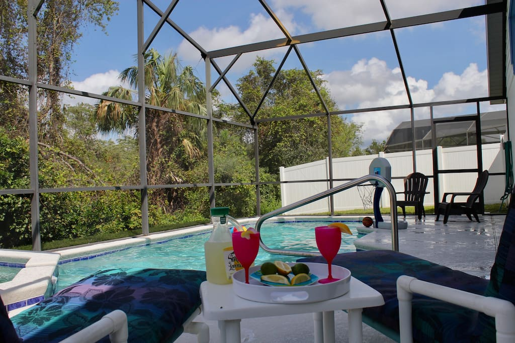 A private pool and spa with a relaxing view of the natural surroundings.