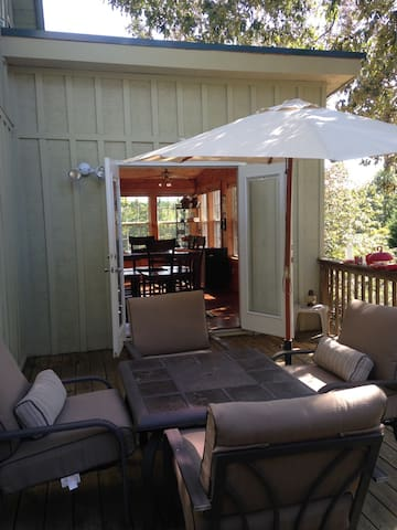Front wrap around patio leading to dining room