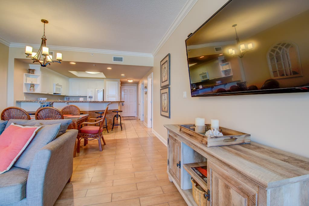 Relax in your elegant living area featuring beautiful wood grain ceramic tile, HUGE flat screen HDTV and ample seating for everyone. There's extra sleeping available in the living area on the Queen sofa sleeper.